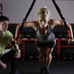personal trainer and client strength training
